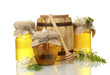 Sweet honey in barrel and jars with acacia flowers isolated