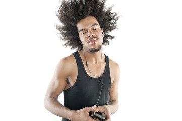 Young man shaking head while listening to mp3 player over white background