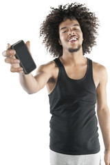 Portrait of a happy young man showing mobile phone over white background