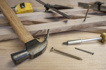 carpenter tools on construction background