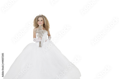 Bride girl holding crucifix wearing wedding gown over white background