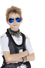 Portrait of punk pre-teen boy wearing sunglasses with arms crossed over white background