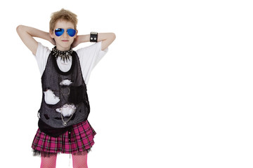 Portrait of punk kid in fancy dress with hands behind head over white background