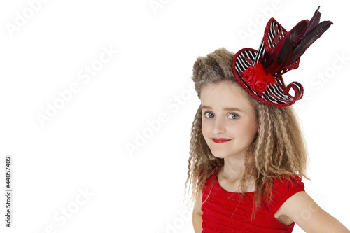 Portrait of school girl wearing headgear over white background