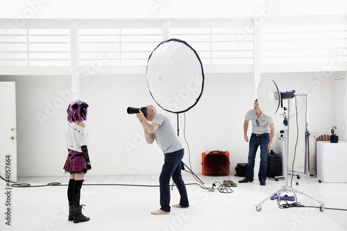 Photographer shooting fashion model in photo shoot