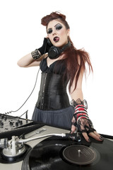 Portrait of beautiful punk DJ with sound mixing equipment over white background