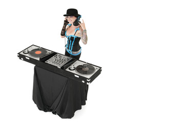 Portrait of female DJ gesturing rock sign over white background