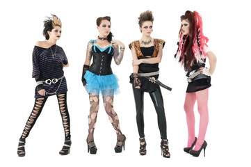 All female rock band members posing over white background