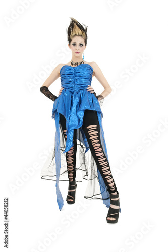 Beautiful young woman wearing ripped dress with spiked hairstyle over white background