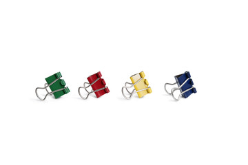 Multicolored bulldog clips over white background