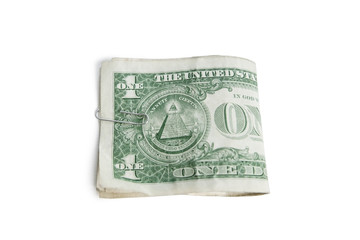 Close-up of paper dollars in clip over white background