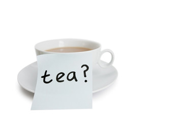 Close-up of sticky notepaper with teacup over white background