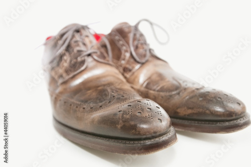 Close-up of men's leather shoe over white background