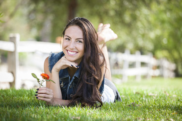 Attractive Mixed Race Girl Portrait Laying in Grass