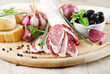 Salami sliced on wooden table