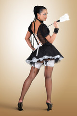 Glamorous pinup style french maid, cleaning concept