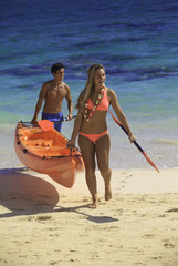 couple at the beach with their kayak