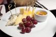 Various cheeses and grapes