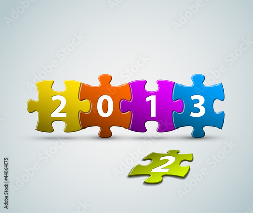 New Year 2013 card made from colorful puzzle pieces