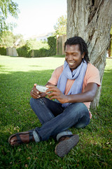 Black man using a smartphone.