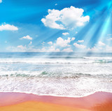 Tropical beach and blue sky with sunrays