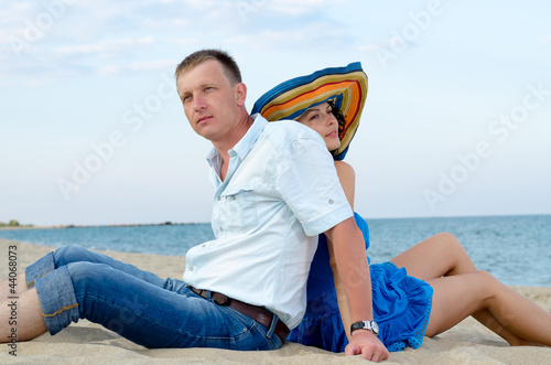 Couple using each other as backrests