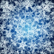 Christmas background made of realistic falling snowflakes.