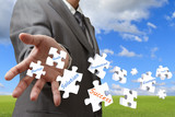 businessman throw puzzles as concept