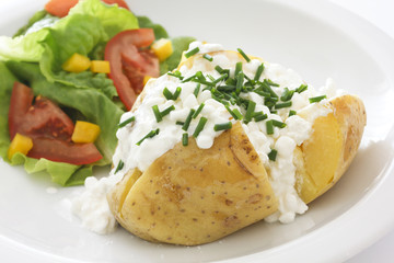 Baked potato with cottage cheese and chives