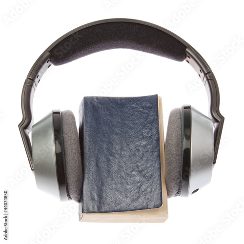 Wireless headphones and a book. On a white background.