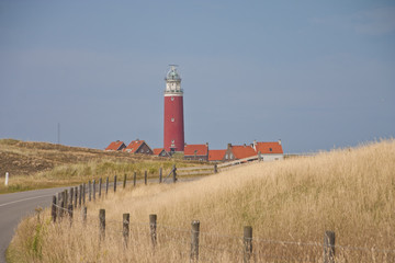 Red lighthouse, little houses on Texel island