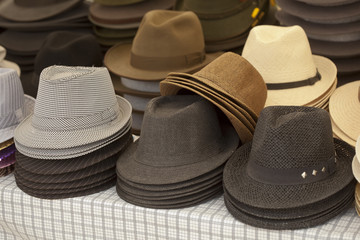 Various hat in assortment pile