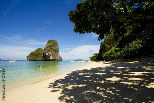 white sand beach under tree shadow and island of Krabi, Thailand
