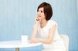 Beautiful young business woman drinking tea