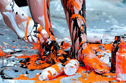 legs painted with black and orange color