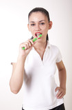 Young attractive girl cleaning her teeth
