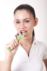 Young attractive girl cleaning her teeth and smiling