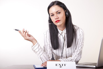 Young attractive female secretary with a sign exit