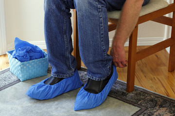 Person Putting on Booties