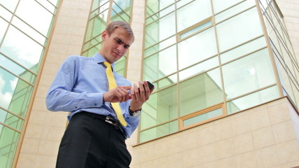 Successful businessman walking and speaking by mobile phone