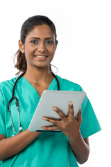Indian Female doctor holding a digital tablet.