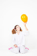 girl with a pajamas with multi-colored balloons