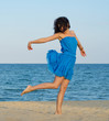 Woman posing on a sandy beach