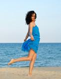 Woman posing at the beach