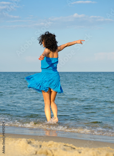 Woman dancing in the sea