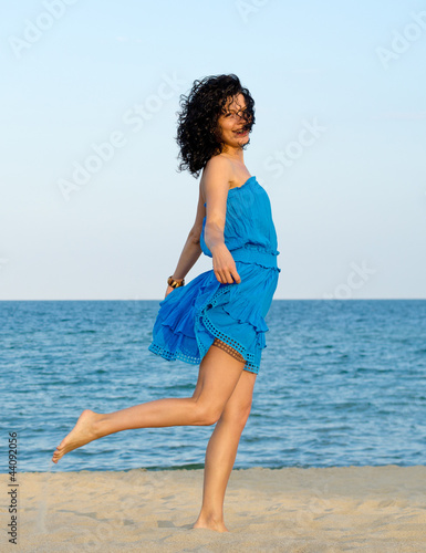 Woman posing at the beach