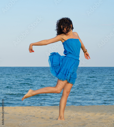 Woman posing on a sandy beach