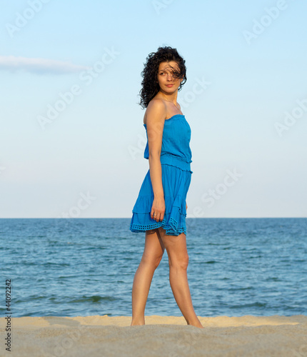 Woman posing on a beach