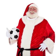 Weihnachtsmann hält Fußball