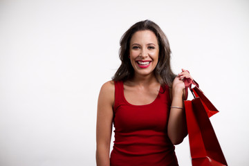 Beautiful brunette girl holding shopping bags